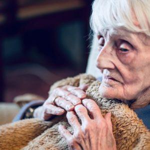 elderly woman under blanket